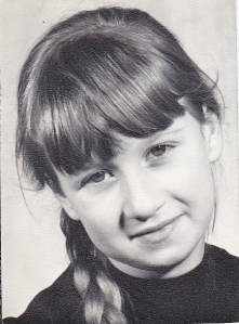 B&W photo of young J with plait